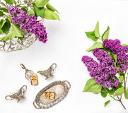 Lilac flowers. Coffee tea pie table dishes. Flat lay Royalty Free Stock Photos