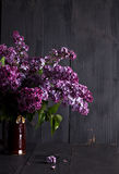 lilac flowers on a dark wooden background Royalty Free Stock Photography