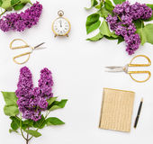 Lilac flowers, diary notebook, golden office supplies Royalty Free Stock Photography