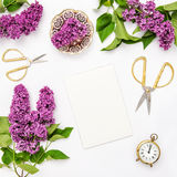 Lilac flowers, notebook, golden accessories. Flat lay sketchbook Royalty Free Stock Photos