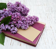 Lilac flowers and old book Royalty Free Stock Photo