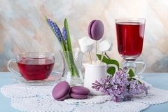 Lilac flowers and purple French macaroons cookies stock photography