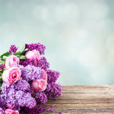 Lilac flowers with roses Royalty Free Stock Image