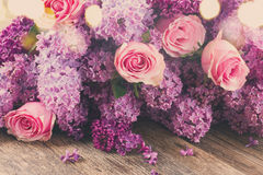 Lilac flowers and roses Royalty Free Stock Images