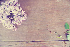 Lilac flowers on rustic wooden table; vintage concept. Stock Photography