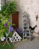 Lilac flowers and various objects in the corner of the castle of Strassoldo Friuli (Italy) Royalty Free Stock Photo