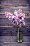 Lilac flowers in vase. Style nostalgia Stock Photos
