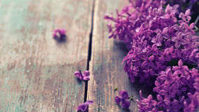 Lilac flowers on  vintage  wooden background. Stock Photos