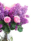 Lilac flowers. Violet Lilac flowers with pink roses isolated on white background Stock Photo