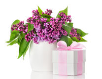 Lilac flowers in a white vase and gift box Royalty Free Stock Photography
