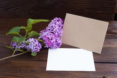 Lilac flowers on wooden table Stock Photo