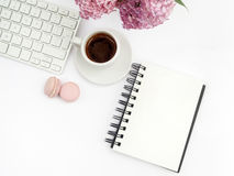 Lilac flowers on workdesk female home office with keyboard and coffee white background top view mockup stock photos