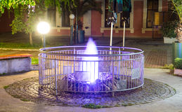Lilac fountain in the center of the old part of the night Pomorie in Bulgaria royalty free stock photo