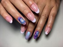 Lilac french manicure with abstraction. And sparkles stock photos