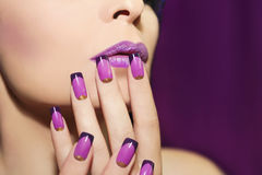 Lilac French manicure. Lilac French manicure for a young woman with purple lips Royalty Free Stock Photography