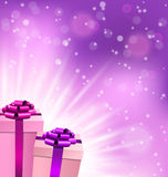 Lilac gift boxes with light on violet Stock Photo