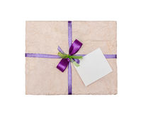 The lilac gift which is elegantly packed into crumpled paper Royalty Free Stock Photo