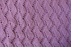 Lilac handmade knit fabric with relief pattern from above Stock Photography