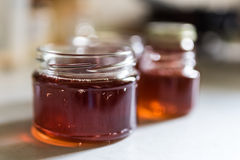 Lilac jelly. In small jars, not covered yet stock photography