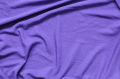 Lilac jersey cloth. Lilac jersey textile laying loose on a table Royalty Free Stock Image