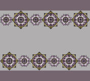 Lilac pattern with mandalas. Drawing of a lilac background with the yellow-purple mandalas in geometric style Royalty Free Stock Photos
