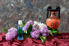 Lilac and perfume in glass bottle Royalty Free Stock Photo