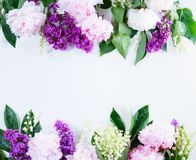 Lilac, pink peonies and lilly of the walley. Floral spring borders - lilac, peonies and lilly of the walley flowers on white background with copy space Stock Image