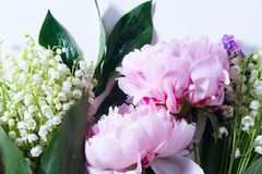 Lilac, pink peonies and lilly of the walley. Top view scene Royalty Free Stock Images