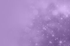 Lilac Purple Star Fade Background. A lilac purple background with bokeh and sparkling stars, fading towards solid colour copy space on the left side Stock Photo