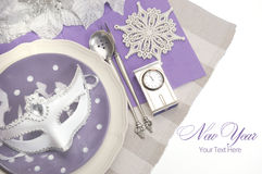 Lilac purple theme elegant Happy New Year dining table place settings Royalty Free Stock Images