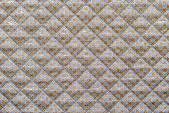 Lilac quilted fabric with a brown crosses Stock Photo