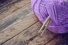 Lilac skein of yarn, wooden knitting needles Royalty Free Stock Photo