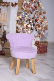 The lilac small chair costs stock photography