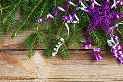 Lilac star and decoration on wooden board Stock Photography