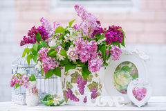 Lilac still life. Beautiful still life with lilac and interior decoration details royalty free stock image