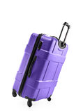 Lilac suitcase plastic on two wheels Stock Photo