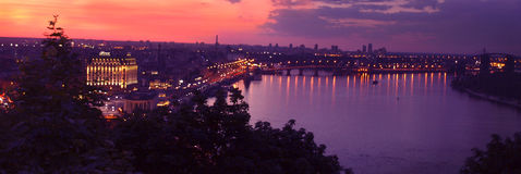 Lilac sunset over the city of Kiev. Kiev, Ukraine. Night view of the embankment in the area of Postal Square Royalty Free Stock Photos