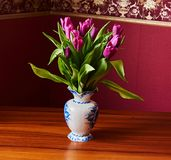 A lilac tulip bud. Macrophoto. Lilac tulips in a decorative vase stand on a table. Russia, Moscow, holiday, gift, mood, nature, flower, plant, bouquet, macro Royalty Free Stock Images