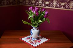 Lilac Tulips. Bud, petals, bouquet. Unopened lilac tulip bud close-up a decorative vase stand on a table. Russia, Moscow, holiday, gift, mood, nature, flower Stock Photo