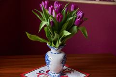 Lilac Tulips. Bud, petals, bouquet. Lilac tulips in a decorative vase stand on a table. Russia, Moscow, holiday, gift, mood, nature, flower, plant, bouquet Royalty Free Stock Photo