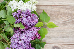 Lilac in vase. Fresh lilac flowers on wooden background with copy space Stock Image