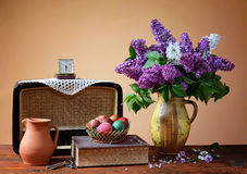 Lilac in a vase, old radio and easter eggs stock images
