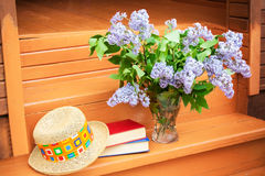 Lilac in vase standing on the painted wooden step Royalty Free Stock Photos