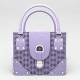 Lilac wicker handbag Royalty Free Stock Photos