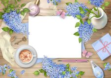 Lilac on wooden background. Spring top view composition with blank sheet of paper, pen, gift, perfume and blossoming tree branches in a ceramic vase