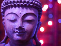 Lilac Wooden Buddha with lights Royalty Free Stock Photo