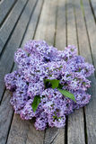 Lilac on wooden surface Stock Image