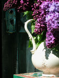 Lilacs. Pitcher of lilacs by old blue barn door Stock Photos