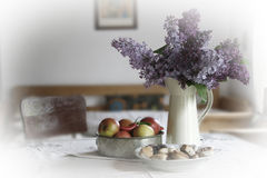 Lilacs and apples Stock Photo