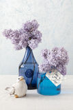 Lilacs in blue vases and a card with the words: Love you Royalty Free Stock Photo